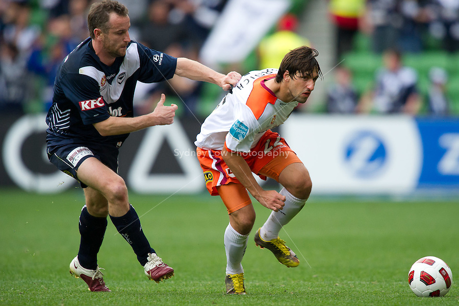 MELBOURNE, AUSTRALIA - SEPTEMBER 12, 2010: Grant Brebner from the Victory fights for the ball with Thomas Broich from the Roar in Round 6 of the 2010 A-League between the Melbourne Victory and Brisbane Roar at AAMI Park on September 12, 2010 in Melbourne, Australia. (Photo by Sydney Low / Asterisk Images)