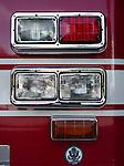 Close-up of a firetruck's front headlights.