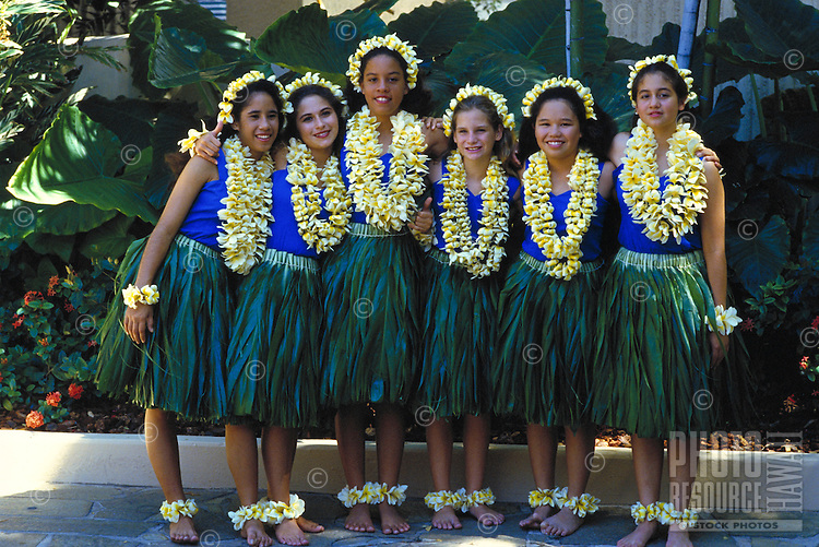 Young hula troupe (halau) after performance with plumeria leis