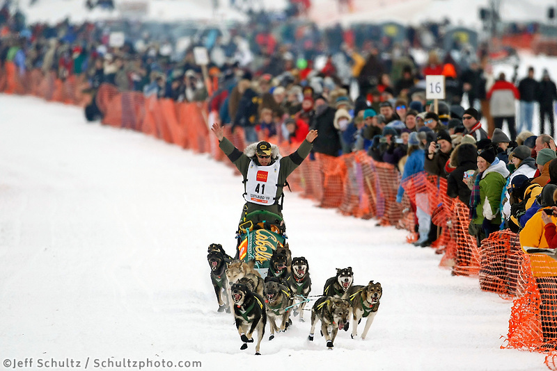 Jeff King waves to the crowd on Willow Lake on Sunday during the restart day of Iditarod 2009 in Willow , Alaska
