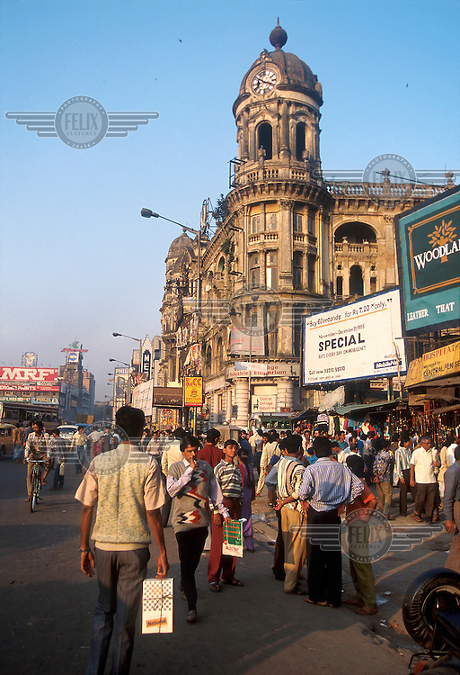 India, Calcutta..Pedestrians on Chowringhee Rd downtown, with decaying colonial era buildings and advertising...Mark Henley