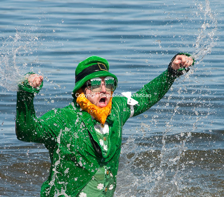 MIDDLEBURY, CT, 20 MARCH 2011-032011JS06--Gorden (cq) Hiltz of Naugatuck cheers as he emerges from the icy cold water during the annual Penguin Plunge to benefit the Special Olympics Connecticut Sunday at Quassy Amusement Park in Middlebury. Hiltz's team raised over $7500 for the event.  <br /> Jim Shannon/Republican-American