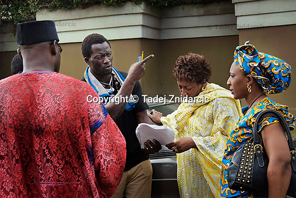Film director Ola Orlando Shoyinka (left) discusses the script with actresses Patience Ozokwo (center) and Ngozi Doomanbey (right) on the set of a Nollywood movie production. Shoyinka's movie, a story about a businessman who doesn't stop at murder and seeks help of a magic spell to get to the wife of his business partner, but goes mad at the end and confesses all his sins, is one of a couple of thousand movies made in Nigeria each year.