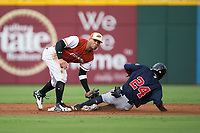 Yoan Moncada (10) of the Charlotte Pitmasters tags out Ronald Acuna (24) of the Gwinnett Braves as he tries to steal second base at BB&T BallPark on July 15, 2017 in Charlotte, North Carolina.  The Braves defeated the Pitmasters 9-4.  (Brian Westerholt/Four Seam Images)