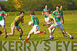 Sean O'Connor for St Michaels Foilmore trying to clear his lines as he runs into a strong Finuge line of Paul Galvin and Michael Stackpoole.