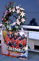 Photo by Rick WIlson--2/1/03--Mourners flock to the Astronauts Memorial at the John F. Kennedy Space Center Visitors Complex in Titusville, Fl. to pay their respects to the crew of the Space Shuttle Columbia who perished during re-entry over Texas enroute to landing at Cape Canaveral in Florida...