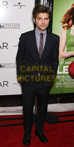 "ADAM SCOTT .attend the World Premiere of ""Leap Year"" at the Directors Guild Theater, New York, NY, USA, 6th January 2010..arrivals full length red striped tie checked gingham shirt navy blue grey gray suit hands in pockets .CAP/LNC/TOM.©LNC/Capital Pictures"