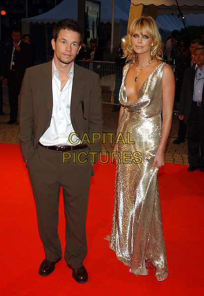 "MARK WALHBERG & CHARLIZE THERON.at screening of their film.""The Italian Job"".Deauville Film Festival.full length silver dress.sales@capitalpictures.com.www.capitalpictures.com.©Capital Pictures"