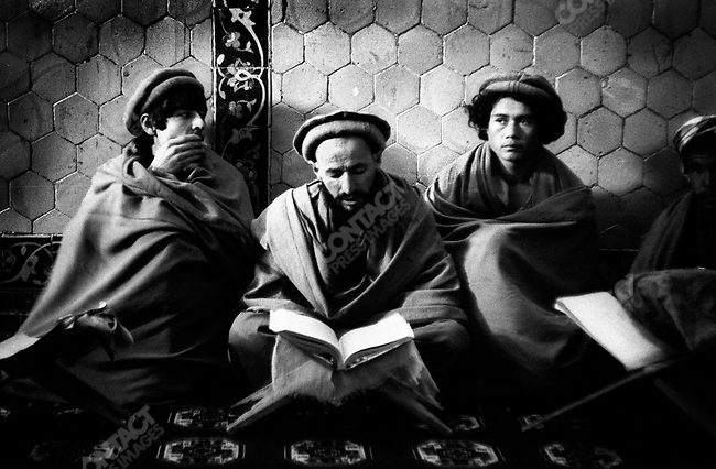 Reading the Koran in the Blue Mosque, Masar, Afghanistan. 1993.