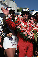 LONG BEACH, CA - APRIL 3: Mario Andretti celebrates in victory lane after winning the 1977 United States Grand Prix West on April 3, 1977, at the Long Beach Street Circuit in Long Beach, California.