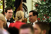 United States Secretary of the Treasury Steven T. Mnunchin (R) talks to First Daughter and Advisor to the President Ivanka Trump and her husband Senior Advisor Jared Kushner at the Congressional Ball at White House in Washington on December 15, 2018.<br /> Credit: Yuri Gripas / Pool via CNP