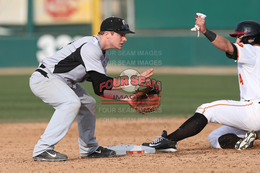 Tyler Janish (42) of the Oakland Grizzlies waits for the throw as Bobby Stahel of the Southern California Trojans slides into second base during a game at Dedeaux Field on February 21, 2015 in Los Angeles, California. Southern California defeated Oakland, 11-1. (Larry Goren/Four Seam Images)