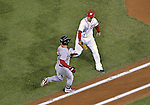 12 October 2012: Washington Nationals first baseman Adam LaRoche gets Skip Schumaker out on the base path to first during Postseason Playoff Game 5 of the National League Divisional Series against the St. Louis Cardinals at Nationals Park in Washington, DC. The Cardinals stunned the home team with a four-run rally in the 9th inning to defeat the Nationals 9-7 and win the NLDS, moving on to the NL Championship Series. Mandatory Credit: Ed Wolfstein Photo