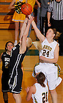 SPEARFISH, SD - FEBRUARY 22, 2014:  Courtney Patterson #24 of Black Hills State reaches for a rebound above Abby Kirchoff #20 of UC-Colorado Springs during their Rocky Mountain Athletic Conference game Saturday at the Donald E. Young Center in Spearfish, S.D.  (Photo by Dick Carlson/Inertia)