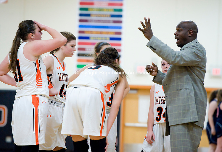 WATERTOWN, CT-011118JS08---Watertown head coach Jason Hurdle, right, talks with his players during a time out in their non-league game against New Fairfield Thursday at Watertown High School.<br />  Jim Shannon Republican-American