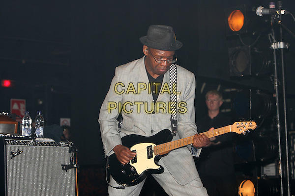 THE SPECIALS.Live at the Brixton Academy, London, England..May 8th, 2009.stage concert gig performance music half length grey gray suit guitar hat .CAP/MAR.© Martin Harris/Capital Pictures.