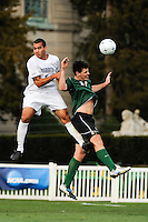 Anthony Vazquez (5) of the Monmouth Hawks and Nick Pappas (24) of the Dartmouth Big Green go up for a header. Dartmouth defeated Monmouth 4-0 during the first round of the 2010 NCAA Division 1 Men's Soccer Championship on the Great Lawn of Monmouth University in West Long Branch, NJ, on November 18, 2010.
