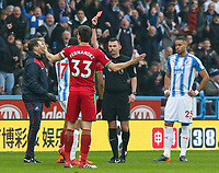 Referee Michael Oliver shows Swansea City's Jordan Ayew (hidden) a straight red card in the first half<br /> <br /> Photographer Alex Dodd/CameraSport<br /> <br /> The Premier League - Huddersfield Town v Swansea City - Saturday 10th March 2018 - John Smith's Stadium - Huddersfield<br /> <br /> World Copyright &copy; 2018 CameraSport. All rights reserved. 43 Linden Ave. Countesthorpe. Leicester. England. LE8 5PG - Tel: +44 (0) 116 277 4147 - admin@camerasport.com - www.camerasport.com