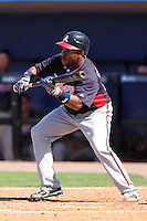 Atlanta Braves outfielder Jose Constanza #17 bunts during a spring training game against the New York Mets at Digital Domain Park on March 27, 2012 in Port St. Lucie, Florida.  Atlanta defeated New York 7-5.  (Mike Janes/Four Seam Images)