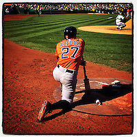 OAKLAND, CA - SEPTEMBER 7: Instagram of Jose Altuve of the Houston Astros kneeling in the on deck circle during the game against the Oakland Athletics at O.co Coliseum on September 7, 2014 in Oakland, California. Photo by Brad Mangin