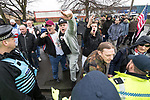 © Joel Goodman - 07973 332324 . 20/01/2018. Doncaster, UK. EDL protesters march through Hexthorpe on the way to the demonstration . Far-right street protest movement , the English Defence League ( EDL ) , hold a demonstration , opposed by anti-fascists , including Unite Against Fascism ( UAF ) in the Hexthorpe area of Doncaster . EDL supporters chanted anti-Roma slogans as they marched through the town . Photo credit : Joel Goodman