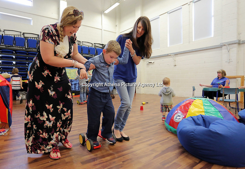 Willz Dewson (C) with his mum Eve (L) and centre worker Anne Barker (R)