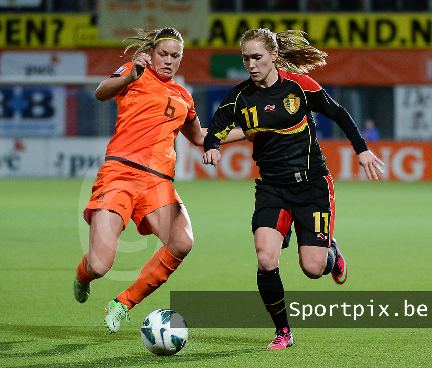 20140212 - ZWOLLE , THE NETHERLANDS : Belgian Janice Cayman (11) pictured with Dutch Anouk Dekker (6) during the female soccer match between The Netherlands and Belgium , on the fifth matchday in group 5 of the UEFA qualifying round to the FIFA Women World Cup in Canada 2015 at Het Ijseldelta Stadion , Zwolle . Wednesday 12th February 2014 . PHOTO DAVID CATRY