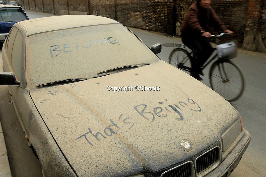 A car that was left coated in dust after the worst dust storm in five years in Beijing. Beijing was preparing to use artificial rain-making to clear the air after a choking dust storm coated China's capital in yellow grit, prompting a health warning to keep children indoors.  The storms are expected to last a few days in Beijing, neighboring Tianjin and a swath of north China stretching from Jilin province in the northeast through Inner Mongolia to Xinjiang in the desert northwest. .18 Apr 2006