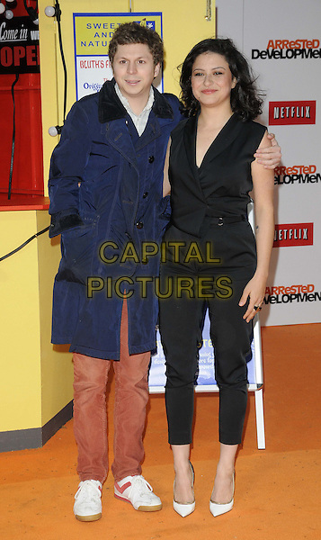 "Michael Cera & Alia Shawkat.attended the ""Arrested Development, Season 4"" UK TV premiere, Vue West End cinema, Leicester Square, London, England, UK, .9th May 2013..full length blue navy trench coat mac .CAP/CAN.©Can Nguyen/Capital Pictures."