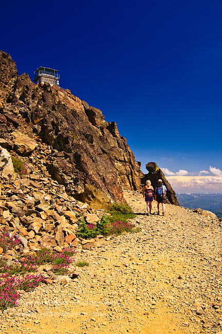 Couple hiking up to the Sierra Buttes Fire Lookout, Sierra County, Northern California.