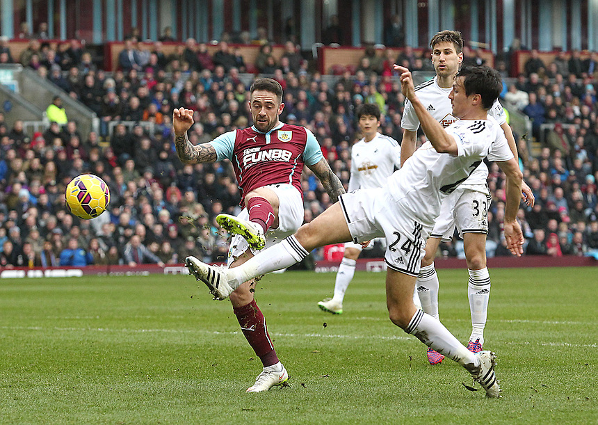 Burnley's Danny Ings shots under pressure from Swansea City's Jack Cork<br /> <br /> Photographer Rich Linley/CameraSport<br /> <br /> Football - Barclays Premiership - Burnley v Swansea City - Friday 27th February 2015 - Turf Moor - Burnley<br /> <br /> &copy; CameraSport - 43 Linden Ave. Countesthorpe. Leicester. England. LE8 5PG - Tel: +44 (0) 116 277 4147 - admin@camerasport.com - www.camerasport.com