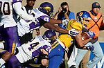 BROOKINGS, SD - OCTOBER 24:  Jake Wieneke #19 from South Dakota State gets a couple extra yards while being brought down by Rickey Neal #26 and Tim Kilfoy #24 from University of Northern Iowa in the third quarter of their game Saturday afternoon at Coughlin Alumni Stadium in Brookings. (Photo by Dave Eggen/Inertia)