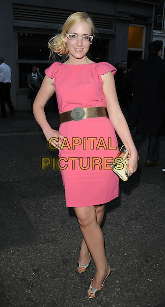 """NICKY HAMBELTON-JONES .At the """"A Midsummer Night's Dream"""" Fundraiser, Diu Nightclub, London, England, UK, June 16th 2010..full length pink dress hand on hip gold waist  belt clutch bag glasses open toe metallic shiny shoes .CAP/CAN.©Can Nguyen/Capital Pictures."""