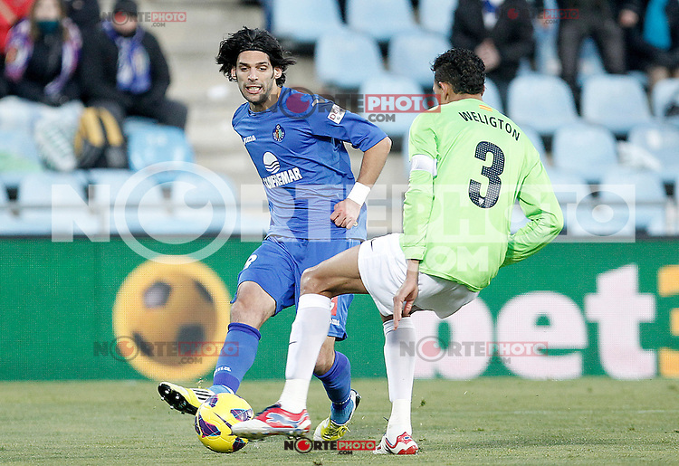 Getafe's Angel Lafita (l) and Malaga's Weligton Robson during La Liga match.December 01,2012. (ALTERPHOTOS/Acero) ©/NortePhoto