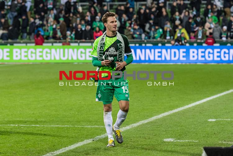 10.02.2019, Weserstadion, Bremen, GER, 1.FBL, Werder Bremen vs FC Augsburg<br /> <br /> DFL REGULATIONS PROHIBIT ANY USE OF PHOTOGRAPHS AS IMAGE SEQUENCES AND/OR QUASI-VIDEO.<br /> <br /> im Bild / picture shows<br /> Sebastian Langkamp (Werder Bremen #15) verschenkt Jubil&auml;um-Schaals an Fans nach Spielende, <br /> <br /> Foto &copy; nordphoto / Ewert