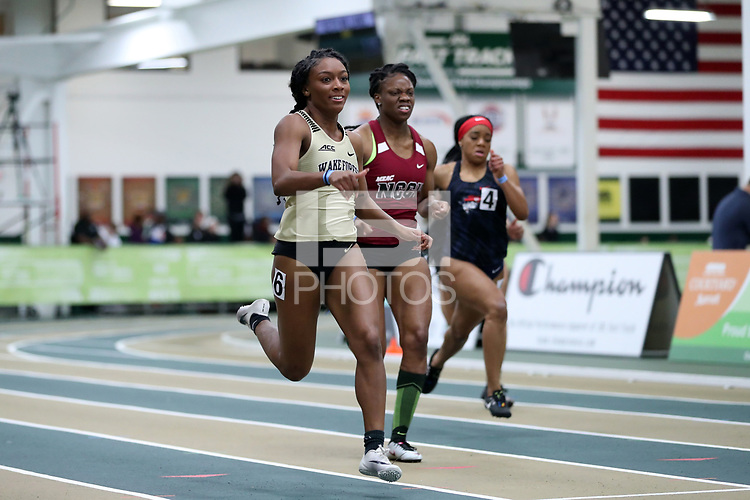 WINSTON-SALEM, NC - FEBRUARY 07: Cydney Delley #6 of Wake Forest University leads Jessica Norman #5 of NC Central University and Dymanique Thompson #4 of Cumberlands University in the Women's 200 Meters at JDL Fast Track on February 07, 2020 in Winston-Salem, North Carolina.