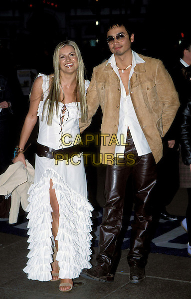 "KATY HILL & TREY FARLEY..""Bend It Like Beckham"" film premiere ..Ref: 11568..couple, gypsy skirt, frills, belt, thigh split, sunglasses, shades, swede jacket..www.capitalpictures.com..sales@capitalpictures.com..©Capital Pictures..full length, full-length"