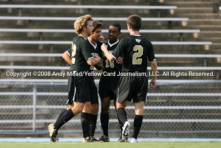 22 August 2008: Wake Forest's Austin da Luz (6) is congratulated by teammates Zack Schilawski (12), Nick Millington (15), and Sam Cronin (2) after scoring a goal. The Wake Forest University Demon Deacons defeated the Virginia Commonwealth University Rams 2-1 at Fetzer Field in Chapel Hill, North Carolina in an NCAA Division I Men's college soccer game.