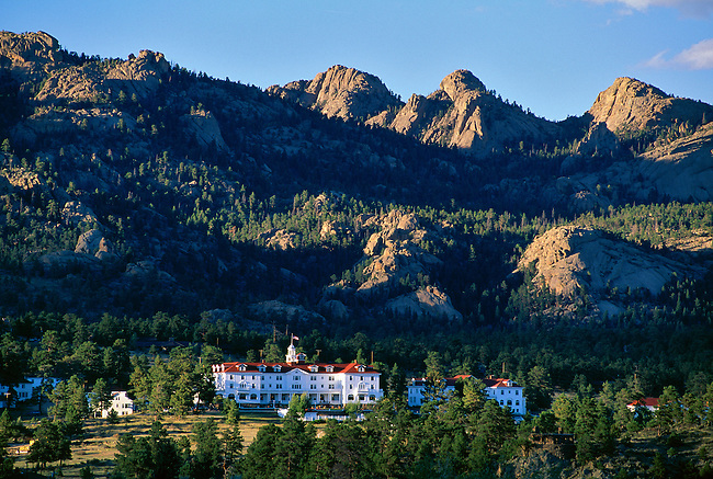 Lumpy Ridge in Rocky Mountain National Park stands above the Stanley Hotel, an historic landmark in Estes Park, Colorado, USA