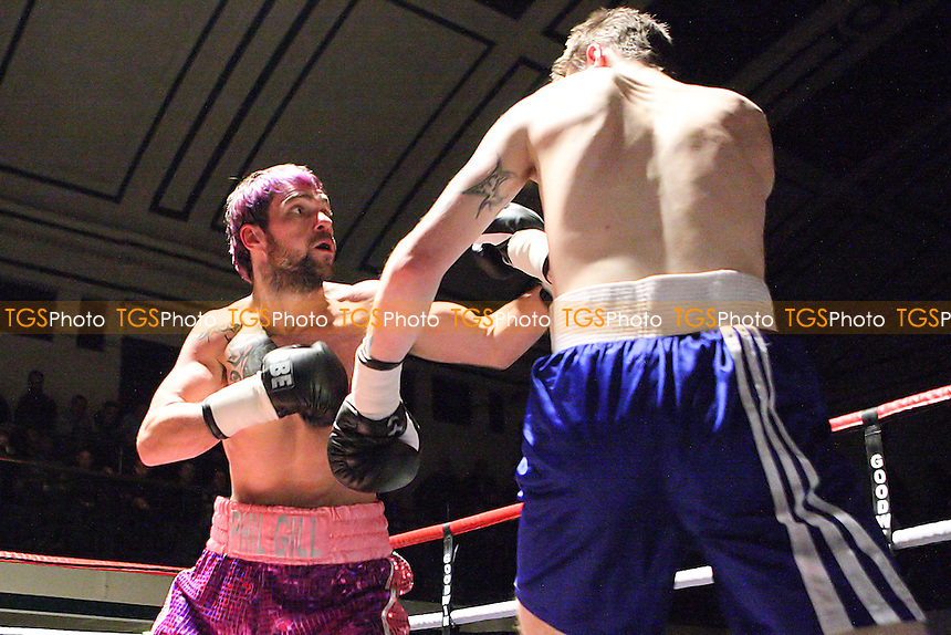 Phil Gill (purple shorts) defeats Craig Dyer in a Light-Welterweight Boxing contest at York Hall, Bethnal Green, promoted by Goodwin Promotions - 04/12/10 - MANDATORY CREDIT: Gavin Ellis/TGSPHOTO - Self billing applies where appropriate - Tel: 0845 094 6026