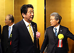 January 5, 2017, Tokyo, Japan - Japanese Prime Minister Shinzo Abe (C) is greeted by Japanese business group leaders Akio Mimura (L) and Sadayuki Sakakibara (R) for a business leaders' New Year party at a Tokyo hotel on Tuesday, January 5, 2017.  (Photo by Yoshio Tsunoda/AFLO)