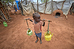 A girl carries water in the Kaya Refugee Camp in Maban County, South Sudan. Kaya is one of four camps in Maban County that together shelter more than 130,000 refugees from the Blue Nile region of Sudan. Misean Cara provides support for the work of Jesuit Refugee Service in Maban.