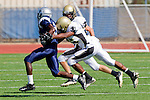 Torrance, CA 09/08/11 - unidentified North player and James Nelson (Peninsula #26) in action during the North-Peninsula Junior Varsity Football game at North High School in Torrance.