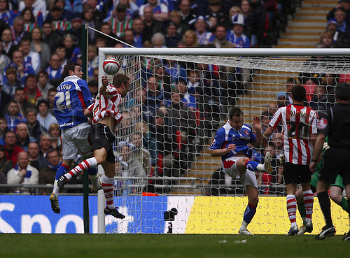 28/03/2010. Rickie Lambert (second from left) and Carlisle's Richard Keogh compete for a first half header in which the referee adjudged that Keogh handled the ball - giving Saints a penalty and their opening goal by Lambert. Southampton v Carlisle United. Johnstone's Paint Trophy Final at Wembley Stadium, London, England, UK