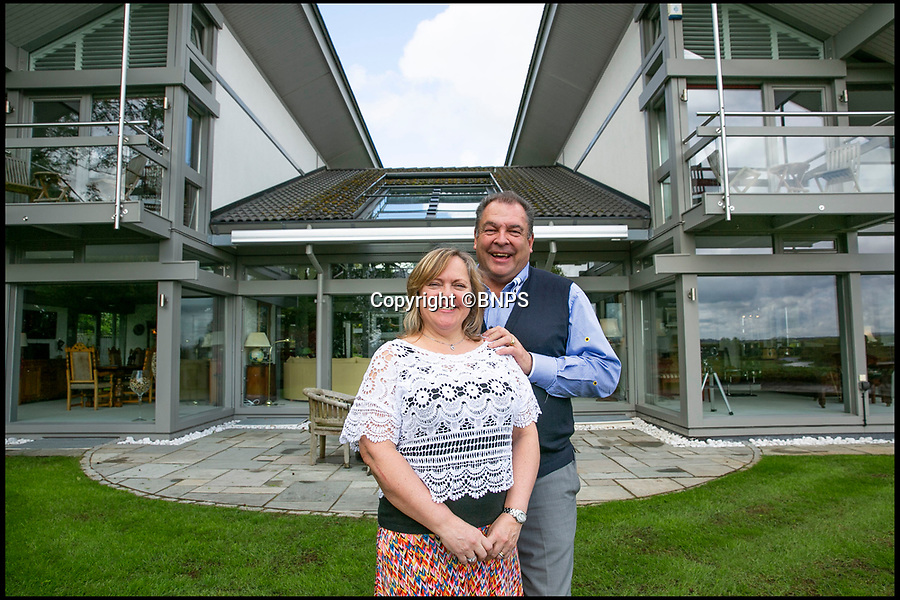 BNPS.co.uk (01202 558833)Pic: LeeMcLean/BNPS<br /> <br /> No Sale - Mark (61) and Sharon Beresford (57) infront of their stunning Huf haus.<br /> <br /> Questions have been asked after the winner of a raffle to win a luxury house was given only £110,000 out of the £750,000 raised<br /> <br /> Mark and Sharon Beresford set up the quirky competition in an attempt to sell their £3m home, Avon Place in Ringwood, Hants but sold just 30,000 tickets out of the 250,000 they needed.<br /> <br /> The raffle raised a whopping £750,000 however the winner of the failed venture recieved just £110,070 - 27 times less than the value of the property.