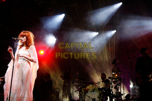 FLORENCE WELCH.Florence and The Machine perform live at Somerset House, London, England..July 15th, 2010.stage concert live gig performance music full length white dress singing arms 3/4 drummer sheer.CAP/MAR.© Martin Harris/Capital Pictures.