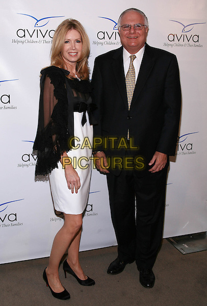 SUSAN CASDEN & ANDY DIAMOND.2009 Impact Awards Aviva Family and Children's Services 'A' Party held at the  SLS Hotel, Beverly Hills, California, USA..April 28th, 2009.full length white dress sheer wrap skirt jacket black suit .CAP/ADM/TC.©T. Conrad/AdMedia/Capital Pictures.