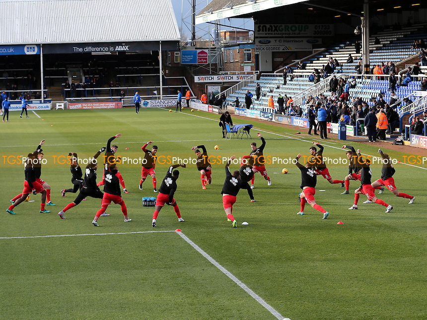 MK Dons warm up pre-match during Peterborough United vs MK Dons, Sky Bet EFL League 1 Football at London Road on 28th January 2017