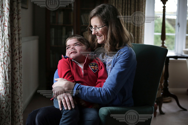 Jonathan Bryan, 11, and his Mother Chantal at their home in Stanton St Quintin. Jonathan has cerebal palsy and has learned to communicate with a spelling board. Since using the board Jonathan has caught up with his age group at school, written a book and started to campaign for non-verbal children.