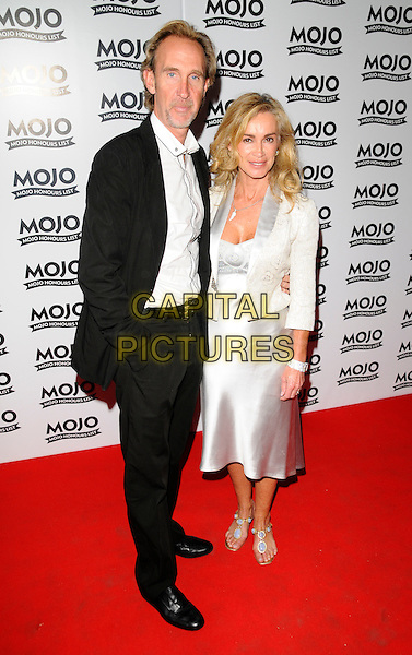 MIKE RUTHERFORD & GUEST.At the Mojo Honours List Awards held at Old Truman Brewery, London, England, June 16th 2008. .arrivals full length black suit silver jacket dress white shirt cream.CAP/CAN.©Can Nguyen/Capital Pictures